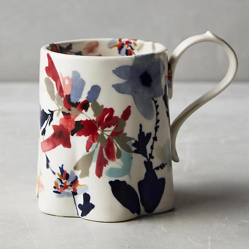 """<p>Gift this sweet, delicate mug to your office-dweller friends and family. </p><p>Buy it <a rel=""""nofollow noopener"""" href=""""http://click.linksynergy.com/fs-bin/click?id=93xLBvPhAeE&subid=0&offerid=460756.1&type=10&tmpid=16680&RD_PARM1=https%3A%2F%2Fwww.anthropologie.com%2Fshop%2Fwildflower-study-mug%3Fcategory=kitchen-mugs-teacups%2526color=000&u1=ISSPWORKAHOLICGIFTGUIDE"""" target=""""_blank"""" data-ylk=""""slk:here"""" class=""""link rapid-noclick-resp"""">here</a> for $12.</p>"""