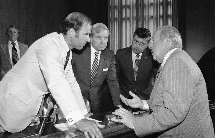 FILE - In this July 13, 1982, file photo Secretary of State designate George Shultz, right, speaks with members of the Senate Foreign Relations Committee prior to the start of the afternoon session of the panel on Capitol Hill in Washington. From left. Sen. Joseph Biden, D-Del.; Sen. Charles Percy, R-Ill., chairman of the panel and Sen. Edward Zorinsky, D-Neb. (AP Photo/Ira Schwarz, File)