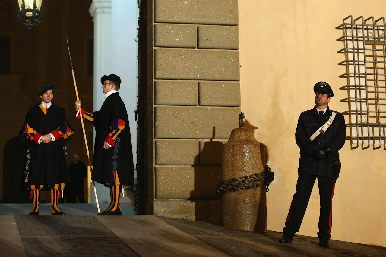 CASTEL GANDOLFO, ITALY - FEBRUARY 28:  Members of the Swiss Guard prepare to close the doors to Pope Benedict XVI's residence in Castel Gandolfo and transfer responsibility for his security to the police as he starts his retirement on February 28, 2013 in Castel Gandolfo, Italy. Pope Benedict XVI has been the leader of the Catholic Church for eight years and is the first Pope to retire since 1415. He will stay at the Papal Summer residence of Castel Gandolfo until renovations are complete at a monastery in the grounds of the Vatican and will be known as Emeritus Pope.  (Photo by Oli Scarff/Getty Images)