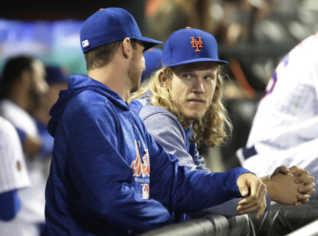 Starting pitcher Noah Syndergaard (right) is one of several New York Mets dealing with an injury. (AP)
