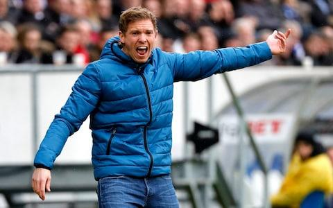"The first thing you notice about Julian Nagelsmann, the TSG Hoffenheim coach and Germany's manager of the year for 2017 is that, despite having just turned 30 last month, he does not try to project himself as a man beyond his years. The manager who will stand in the opposite technical area to Jurgen Klopp on Tuesday night and then again next Wednesday at Anfield is Europe's youngest and most promising coaching talent even though he is 18 months younger than James Milner. A youth team player at Augsburg and 1860 Munchen, his career was cut short by injury before he could turn professional and his story is well-documented now: a rapid rise coaching the youth teams at Hoffenheim's academy before his senior team appointment in October 2015. He took the stage at the Rhein-Neckar Stadium on Tuesday with his defender Kevin Vogt, 25, and the two of them looked like team-mates. Nagelsmann blushes at questions and laughs nervously when praised – he has evidently not adopted the Jose Mourinho approach to press conference bravado although at one point he did reference the ""4,000 books written on football tactics"", which hinted at his scholarly approach. He has been a phenomenon since taking the reins in February last year. Originally the plan was that he would succeed Huub Stevens at the start of last season but the latter's illness and Hoffenheim's plight meant that he came in early. He saved the team from relegation in 2015-2016 season and then took them to fourth last season, their highest-ever finish. Nagelsmann bellows instructions to his players last season  Hoffenheim are a village team whose owner Dietmar Hopp, a software billionaire, has funded a remarkable 21st century rise from the fifth tier of German football. Hoffenheim itself has around 3,200 inhabitants and a small stadium next to the municipal sports centre that the club's academy use. Their 30,150 Rhein-Neckar stadium in neighbouring Sinsheim is their new home and it would be fair to say they are used to doing things differently. This is the club that Roberto Firmino joined Liverpool from and last summer they lost Niklas Sule and Sebastian Rudy to Bayern Munich, the latter as a free agent. Nagelsmann may well end up managing Germany's biggest club himself one day although for the time being he is playing attacking football in a fluid formation that include three defenders and Vogt as a playmaker centre-back. ""We know Liverpool are the favourites in this game,"" Nagelsmann said, ""and we know we must come here and play well if we are going to shock our opponent. I don't know if we need to shock them or shock the English football public. I can only say that our performance will have to be at the very top if we are to do that."" Even the German media seem lost for an explanation as to how Nagelsmann takes it all in his stride. When he was asked how he slept before a game of this magnitude he laughed and replied, ""like this"", shutting his eyes. ""I am no more nervous than in the Bundesliga games,"" he said. ""I get nervous before matches. It is important that these nerves help you to perform better."" Liverpool take on Hoffenheim on Tuesday night  Could his appointment and subsequent success lead to more clubs taking chances on young managers? In England there are just five English Premier League managers and only one, Eddie Howe, in his thirties ""I think the most important thing was that the decision [to appoint me] that TSG took was very courageous,"" Nagelsmann said. ""I showed it can be a success. I want to say that we don't have to think that all we need is young coaches and all the older ones have to leave the game. Everybody has his own qualities and his right to be here. You can say with my success in Germany it opened the door to other young coaches. But if we had been relegated last year it would have been a different story."" He also named Domenico Tedesco the 31-year-old Schalke coach and Hannes Wolf, the 36-year-old Vfb Stuttgart coach as new generation managers who have ""their own qualities"". ""They are not here because of me,"" he said, ""but because of what they have done."" Nagelsmann politely did not point out that both are also older than him."