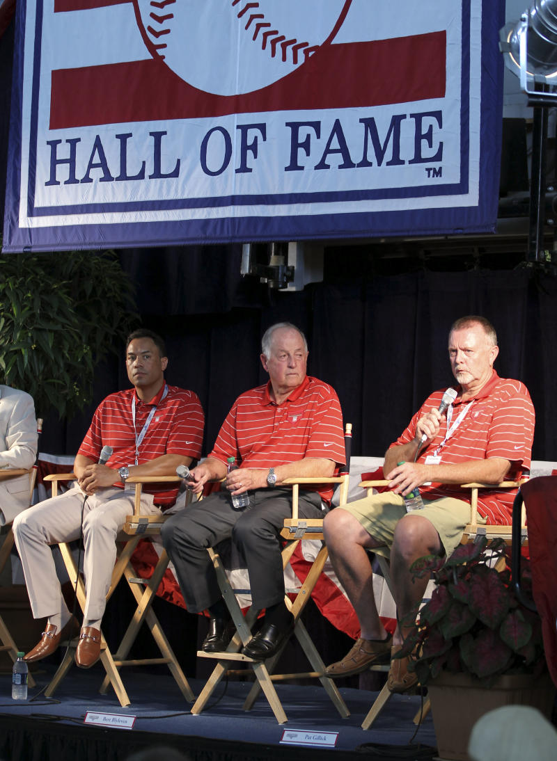Roberto Alomar, left, Pat Gillick, center, and Bert Blyleven answer questions during a news conference in Cooperstown, N.Y., on Saturday, July 23, 2011. All three will be inducted into the Baseball Hall of Fame on Sunday.  (AP Photo/Mike Groll)