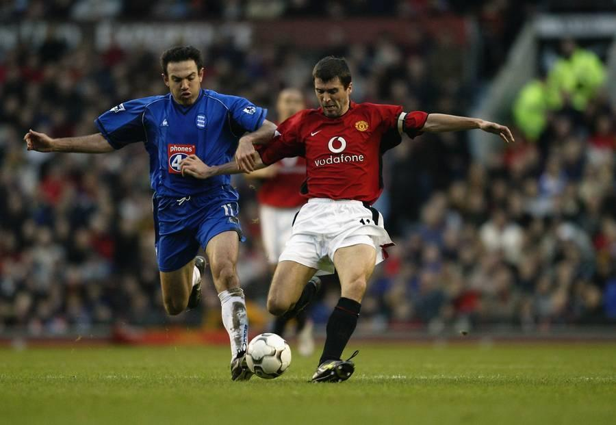 Roy Keane of Manchester United is tackled by Stan Lazaridis of Birmingham City as he attempts to strike the ball