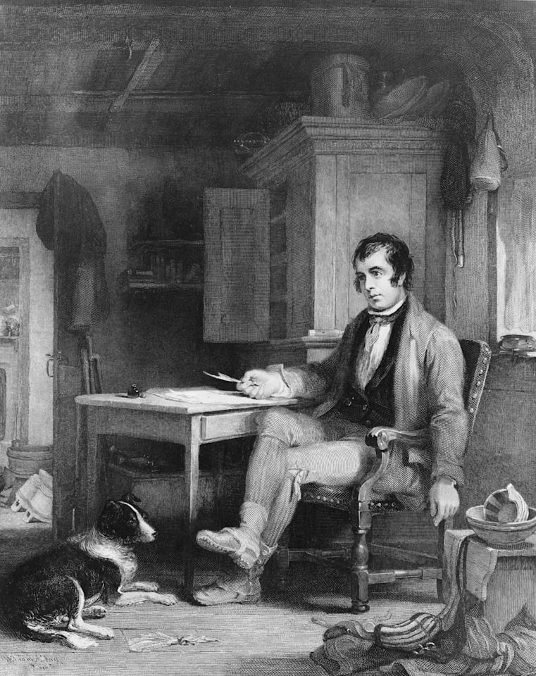 circa 1786: Scottish poet Robbie Burns (1759 - 1796) in his cottage composing 'The Cotter's Saturday Night'. Robert Burns was born in Alloway, Ayrshire, the son of a farmer. In 1786 he published 'Poems, chiefly in the Scottish dialect' with a view to raising funds to emigrate to the West Indies. The success of the volume induced him to stay. He married Jean Armour, the mother of his children in 1788. Burns farmed at Ellisland until 1791 and also worked for the Excise Service to supplement his income. Most of his later literary work consisted of songs and he wrote many of his most famous works for 'A Collection of Original Scottish Airs' which included 'Auld Lang Syne', 'A Red, Red Rose' and 'Scots Wha Hae'. Burns died on July 21st 1796. His life and work are celebrated on Burns Night, 25th January. (Photo by Hulton Archive/Getty Images)