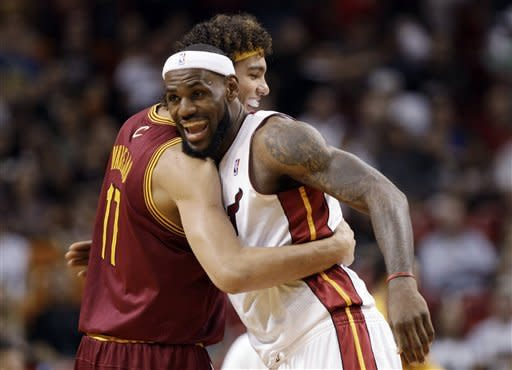 Miami Heat's LeBron James, right, hugs Cleveland Cavaliers' Anderson Varejao (17), of Brazil, before an NBA basketball game, Tuesday, Jan. 24, 2012, in Miami. (AP Photo/Lynne Sladky)