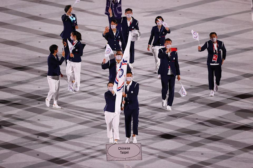 Tokyo 2020 Olympics - The Tokyo 2020 Olympics Opening Ceremony - Olympic Stadium, Tokyo, Japan - July 23, 2021. Lu Yen-hsun of Taiwan and Kuo Hsing-Chun of Taiwan lead their contingent during the athletes' parade at the opening ceremony REUTERS/Mike Blake