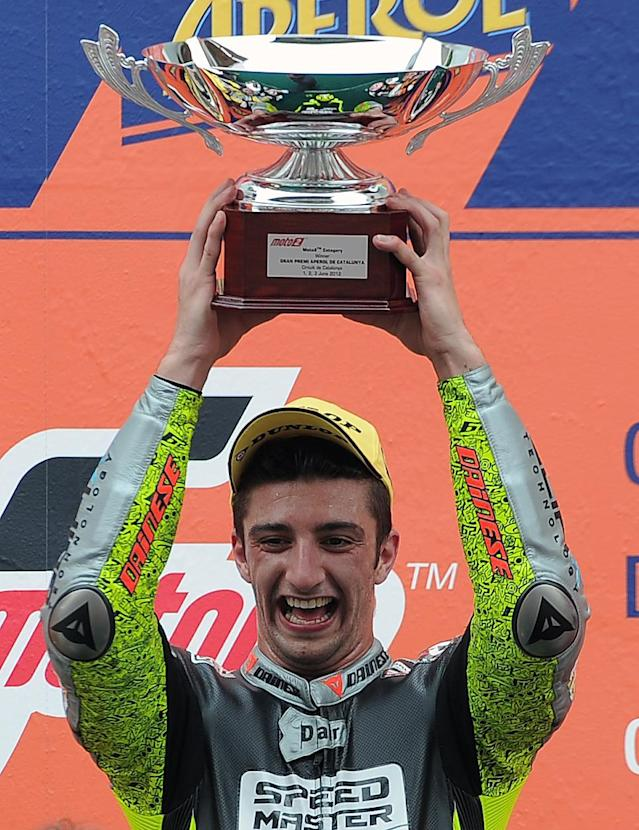 Speed Master's Italian Andrea Iannone celebrates on the podium after winning the Moto2 race of the Catalunya Moto GP Grand Prix at the Catalunya racetrack in Montmelo, near Barcelona, on June 3, 2012. Speed Master's Italian Andrea Iannone won the race ahead of Interwetten-Paddock's Swiss Thomas Luthi and Team CatalunyaCaixa Repsol 's Spanish Marc Marquez. AFP PHOTO / LLUIS GENELLUIS GENE/AFP/GettyImages