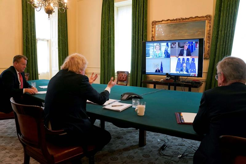 Brexit negotiator, David Frost, Boris Johnson and Michael Gove take part in a video call with EU members (file photo)(10 Downing Street/AFP via Getty)