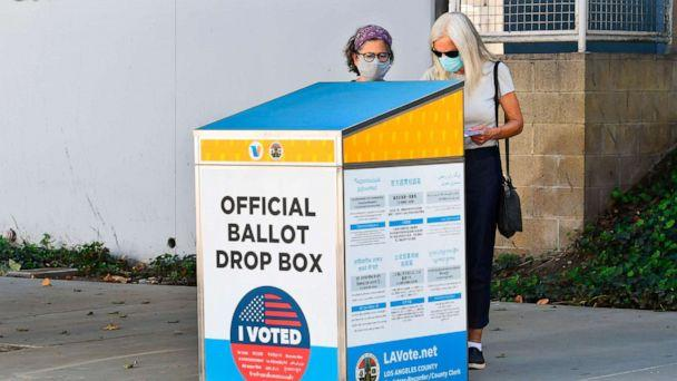 PHOTO: Voters cast their ballots for the 2020 US Elections at an offical ballot drop box on a sidewalk in Los Angeles, Oct. 12, 2020. (Frederic J. Brown/AFP via Getty Images)