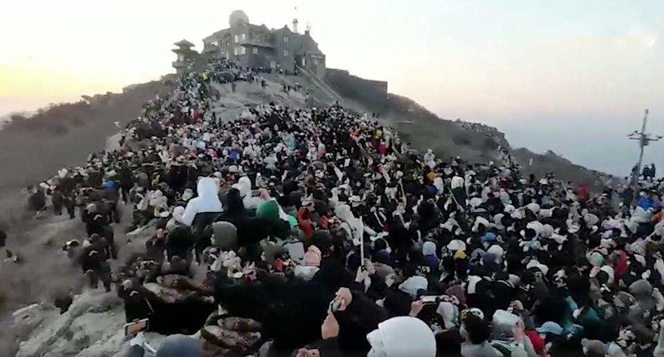 Hundreds of people are seen on top of Mount Tai, China.
