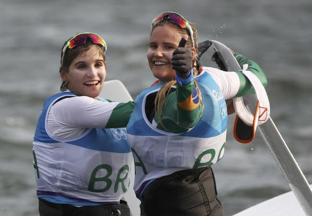2016 Rio Olympics - Sailing - Final - Women's Skiff - 49er FX - Medal Race - Marina de Gloria - Rio de Janeiro, Brazil - 18/08/2016. Martine Grael (BRA) of Brazil and Kahena Kunze (BRA) of Brazil celebrate gold. REUTERS/Benoit Tessier FOR EDITORIAL USE ONLY. NOT FOR SALE FOR MARKETING OR ADVERTISING CAMPAIGNS.