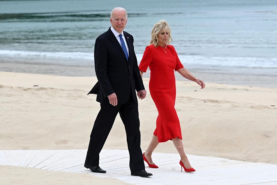 US President Joe Biden and US First Lady Jill Biden arrive for an offial photograph at the start of the G7 summit in Carbis Bay, Cornwall on June 11, 2021. - G7 leaders from Canada, France, Germany, Italy, Japan, the UK and the United States meet this weekend for the first time in nearly two years, for three-day talks in Carbis Bay, Cornwall. (Photo by Leon Neal / POOL / AFP) (Photo by LEON NEAL/POOL/AFP via Getty Images) (Photo: LEON NEAL via Getty Images)
