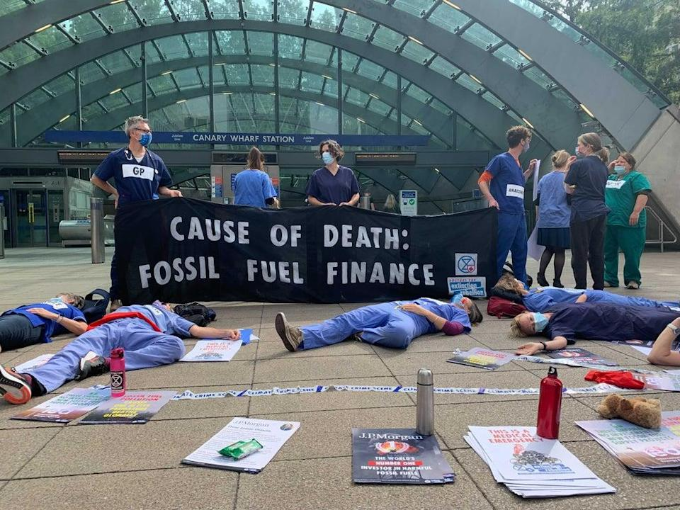 Doctors lay 'dead' in front of Canary Wharf tube station (The Independent)
