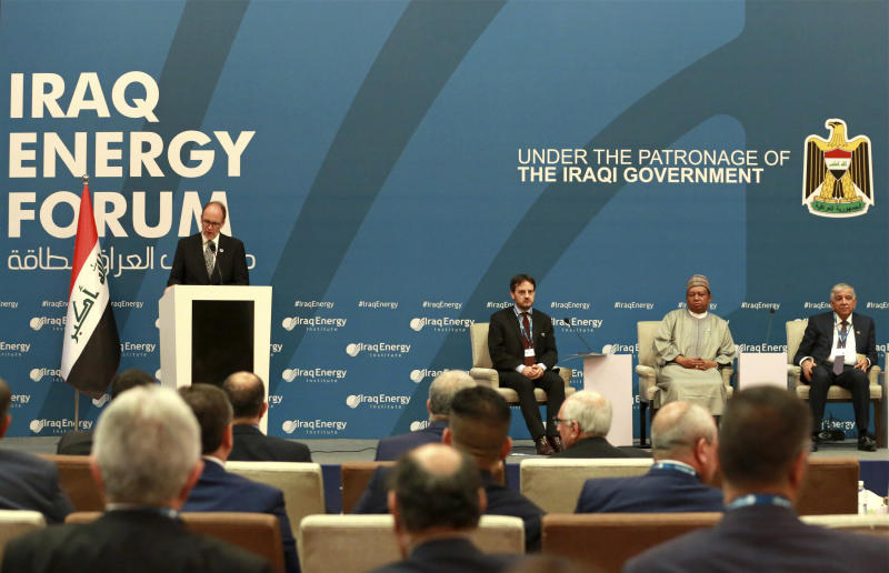 U.S. Ambassador to Iraq Douglas Silliman, left, speaks during Iraq Energy Forum, in Baghdad, Iraq, Sunday, April 2, 2017. Addressing the energy conference, Iraqi Oil Minister Jabar Ali Al-Luaibi said on Sunday that his country plans to increase daily crude oil production to 5 million barrels by the end of this year, up from the current rate of about 4.4 million barrels per day, to secure sorely needed cash for its ailing economy. (AP Photo/Hadi Mizban)