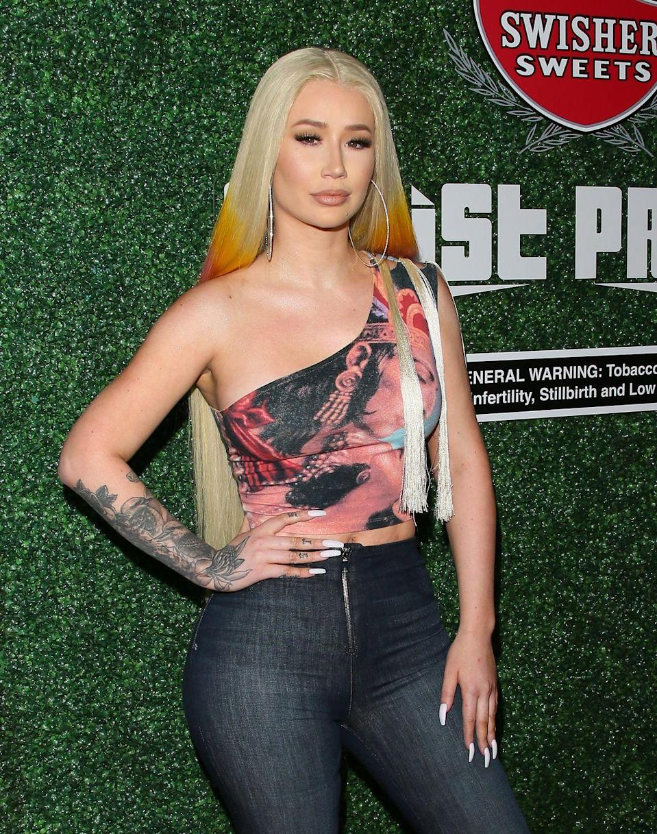 """<p>Iggy Azalea proved that she was too fancy to mess around with having the names of exes still tattooed on her fingers. When the Australian rapper split from A$AP Rocky, she first crossed his name out on the series of tattoos she had on the inside of the fingers that read """"LIVE,"""" """"LOVE,"""" and """"A$AP."""" The Grammy nominee did eventually get the tat removed, according to <em><a href=""""https://www.eonline.com/news/694655/iggy-azalea-removes-a-ap-rocky-tribute-tattoo"""" rel=""""nofollow noopener"""" target=""""_blank"""" data-ylk=""""slk:E!"""" class=""""link rapid-noclick-resp"""">E!</a></em>.</p>"""