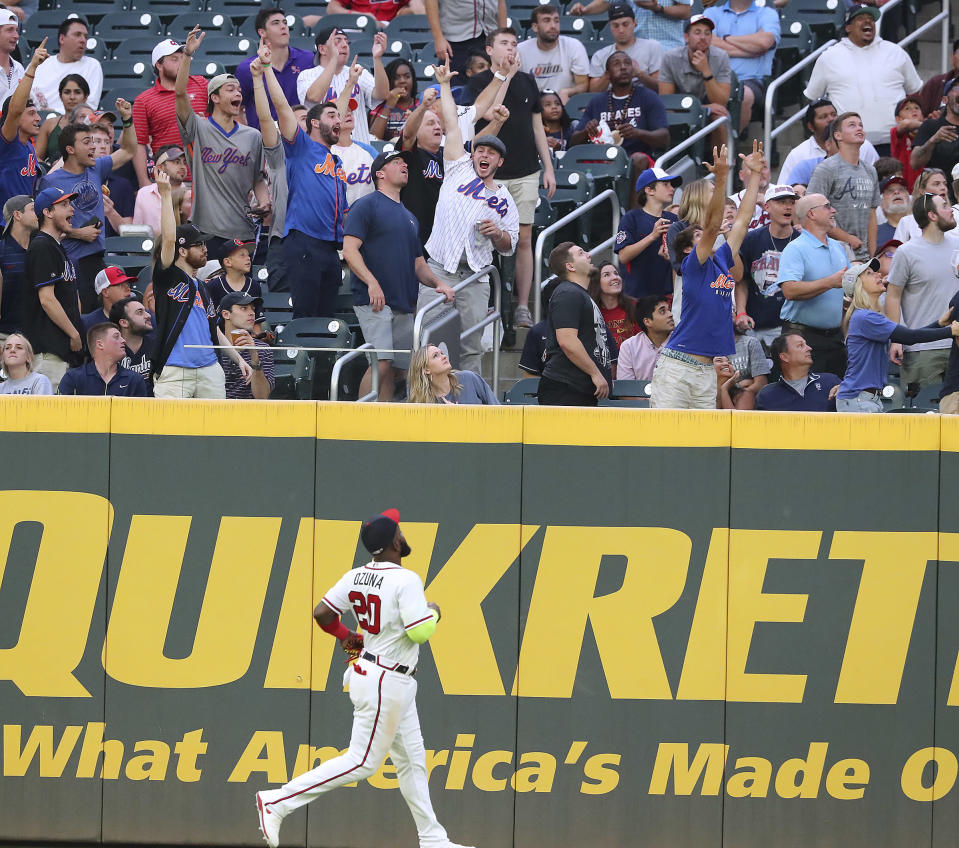 New York Mets fans cheer as Atlanta Braves outfielder Marcell Ozuna watches a two-run home run by Mets' Jonathan Villar during the third inning of a baseball game Tuesday, May 18, 2021, in Atlanta. (Curtis Compton/Atlanta Journal-Constitution via AP)