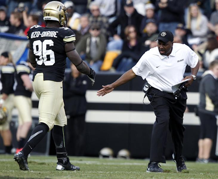 Colorado head coach Jon Embree, right, congratulates defensive end Chidera Uzo-Diribe as he leaves the field against Utah in the third quarter of Utah's 42-35 victory in an NCAA football game in Boulder, Colo., on Friday, Nov. 23, 2012. (AP Photo/David Zalubowski)