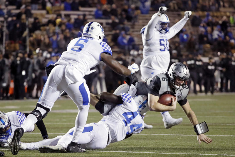Vanderbilt quarterback Riley Neal (6) is stopped by Kentucky linebacker Jamin Davis (44) on a goal line stand in the fourth quarter of an NCAA college football game Saturday, Nov. 16, 2019, in Nashville, Tenn. (AP Photo/Mark Humphrey)