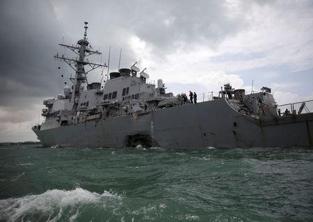 FILE PHOTO: The U.S. Navy guided-missile destroyer USS John S. McCain is seen after a collision, in Singapore waters August 21, 2017. REUTERS/Ahmad Masood/File Photo