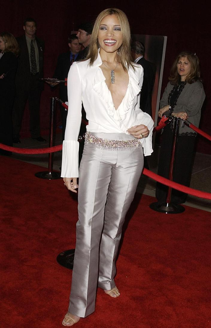 <p><em>ER </em>actress Michael Michele wore a low-cut, ruffled white blouse and silver trousers to the 2001 Emmy awards and looked like a modern, sexy pirate. </p>