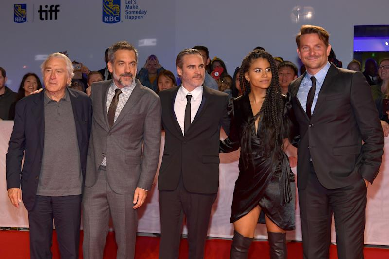 "TORONTO, ONTARIO - SEPTEMBER 09: (L-R) Robert De Niro, Todd Phillips, Joaquin Phoenix, Zazie Beetz and Bradley Cooper attend the ""Joker"" premiere during the 2019 Toronto International Film Festival at Roy Thomson Hall on September 09, 2019 in Toronto, Canada. (Photo by Rodin Eckenroth/WireImage)"