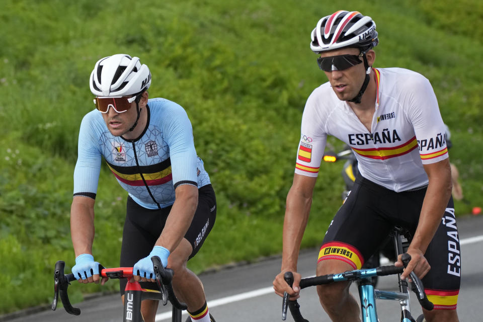 Omar Fraile Matarranz of Spain, right, and Greg van Avermaet of Belgium compete during the men's cycling road race at the 2020 Summer Olympics, Saturday, July 24, 2021, in Oyama, Japan. (AP Photo/Christophe Ena)