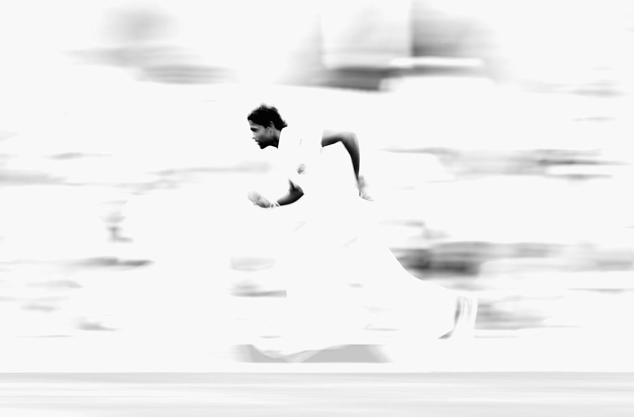 HOBART, AUSTRALIA - DECEMBER 14: (Editor's Note: This image has been converted to black and white)  Shaminda Eranga of Sri Lanka runs in to bowl during day one of the First Test match between Australia and Sri Lanka at Blundstone Arena on December 14, 2012 in Hobart, Australia.  (Photo by Ryan Pierse/Getty Images)