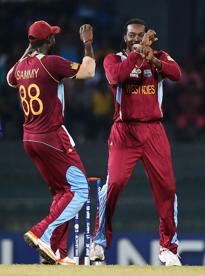 COLOMBO, SRI LANKA - SEPTEMBER 24:  Chris Gayle of the West Indies celebrates the wicket of Niall O'Brien of Ireland with Darren Sammy during the ICC World Twenty20 2012 Group B match between West Indies and Ireland at R. Premadasa Stadium on September 24, 2012 in Colombo, Sri Lanka.  (Photo by Matthew Lewis-ICC/ICC via Getty Images)