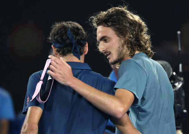 Greece's Stefanos Tsitsipas, right, is congratulated by Switzerland's Roger Federer after winning their fourth round match at the Australian Open tennis championships in Melbourne, Australia, Sunday, Jan. 20, 2019. (AP Photo/Mark Schiefelbein)