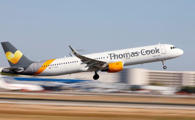 FILE PHOTO: A Thomas Cook Airbus A321 airplane takes off at the airport in Palma de Mallorca