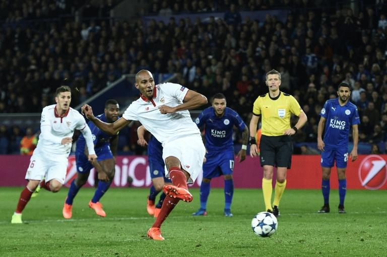 Sevilla's midfielder Steven N'Zonzi (C) takes a penalty that is saved during the UEFA Champions League round of 16 second leg football match between Leicester City and Sevilla at the King Power Stadium on March 14, 2017