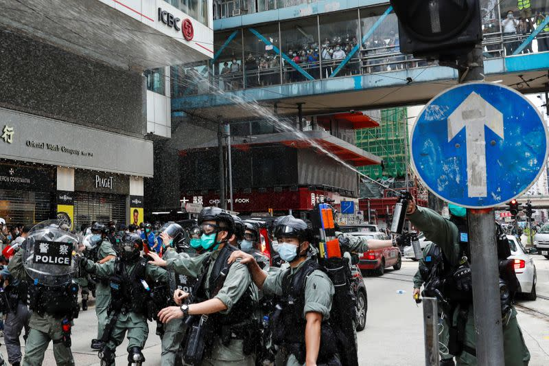 Riot police use pepper spray to disperse anti-government protesters in Hong Kong