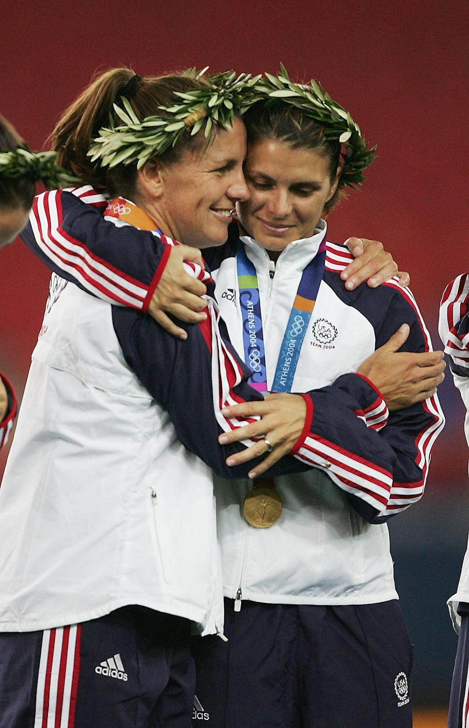 """<p>After years of defining women's soccer in the US, <a href=""""https://www.teamusa.org/News/2015/June/02/Nine-Moments-That-Defined-The-US-Womens-Soccer-Team"""" class=""""link rapid-noclick-resp"""" rel=""""nofollow noopener"""" target=""""_blank"""" data-ylk=""""slk:the &quot;Fab Five&quot; of the epic late-'90s"""">the """"Fab Five"""" of the epic late-'90s</a> announced they were closing out their careers. Mia Hamm, Joy Fawcett, and Julie Foudy announced that their final tournament would be the 2004 Summer Olympics in Athens, and they definitely went out with a bang, <a href=""""https://www.olympic.org/videos/usa-s-olympic-history-in-women-s-football"""" class=""""link rapid-noclick-resp"""" rel=""""nofollow noopener"""" target=""""_blank"""" data-ylk=""""slk:finishing with yet another gold medal"""">finishing with yet another gold medal</a>. </p> <p>The final match against Brazil served as a bridge between the old and new generations in Team USA's soccer history. As the legends of years past ended their careers, the game-winning goal was scored by a young new player named <a href=""""https://www.fifa.com/womensworldcup/news/abby-wambach-usa"""" class=""""link rapid-noclick-resp"""" rel=""""nofollow noopener"""" target=""""_blank"""" data-ylk=""""slk:Abby Wambach"""">Abby Wambach</a>, who would go on to lead the next generation of American soccer stars. </p>"""