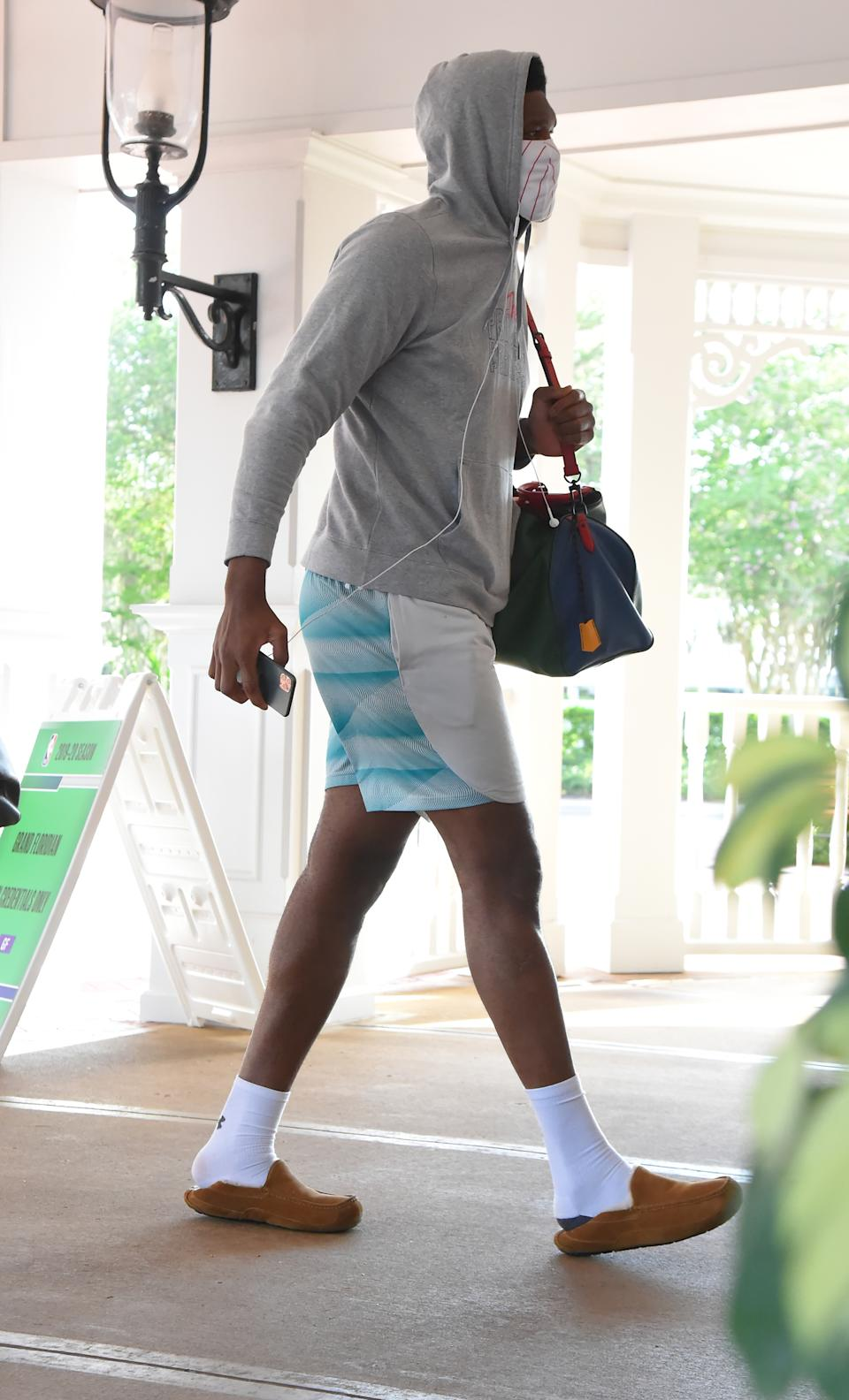 Joel Embiid of the Philadelphia 76ers arrives at the hotel as part of the NBA Restart 2020 on July 9, 2020 in Orlando, Florida. (Photo by Bill Baptist/NBAE via Getty Images)
