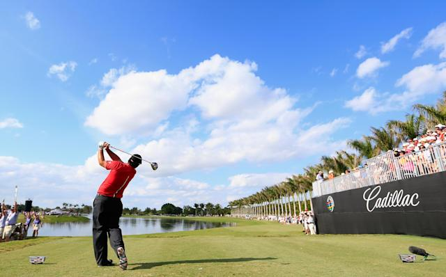 DORAL, FL - MARCH 09: Patrick Reed watches his tee shot on the tenth hole during the final round of the World Golf Championships-Cadillac Championship at Trump National Doral on March 9, 2014 in Doral, Florida. (Photo by Jamie Squire/Getty Images)