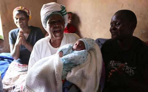 Esther Zinyoro Gwena has become a local hero delivering babies in her tiny Harare apartment for mothers-to-be abandoned by medical facilities forced to close in Zimbabwe's economic crisis - Credit: Tsvangirayi Mukwazhi/AP