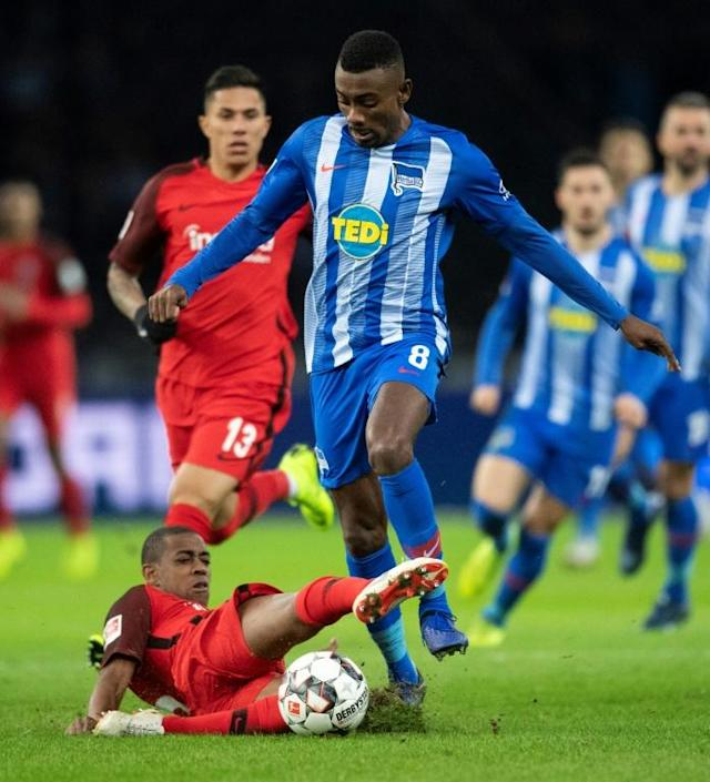 Hertha Berlin have suspended striker Salomon Kalou (R) for posting a video on social media shaking hands with team-mates -- breaching strict hygiene guidelines. and Frankfurt´s Swiss midfielder Gelson Fernandes vie for the ball during the German first division Bundesliga football match between Hertha Berlin v Eintracht Frankfurt at the Olympic stadium in Berlin on December 8, 2018. (AFP Photo/ROBERT MICHAEL)