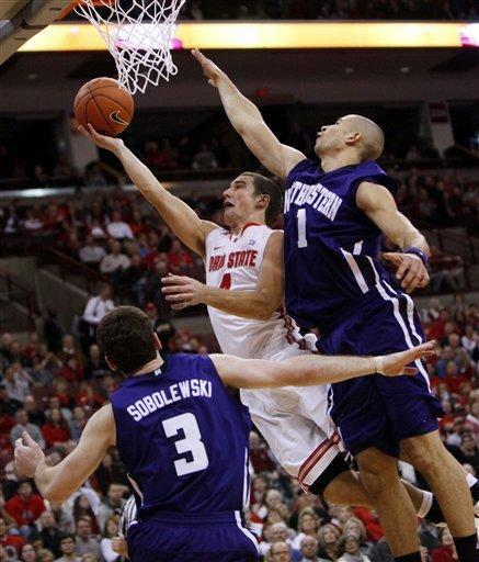 Ohio State's Aaron Craft (4) drives to the basket as Northwestern's Drew Crawford (1) and Dave Sobolewski (3) defend during the first half of an NCAA college basketball game, Wednesday, Dec. 28, 2011, in Columbus, Ohio. (AP Photo/Terry Gilliam)