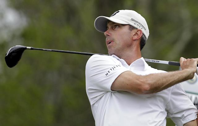 Matt Kuchar tees off on the sixth hole during the first round of the Houston Open golf tournament, Thursday, April 3, 2014, in Humble Texas. (AP Photo/Patric Schneider)