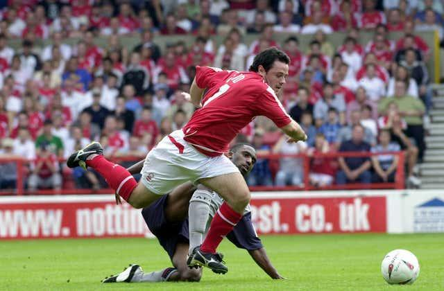 Justin Cochrane tackles Nottingham Forest's Andy Reid during his time at Crewe