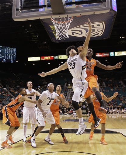 Colorado's Sabatino Chen (23) shoots against Oregon State's Jarmal Reid in the first half during a Pac-12 tournament NCAA college basketball game on Wednesday, March 13, 2013, in Las Vegas. Colorado won 74-68. (AP Photo/Julie Jacobson)
