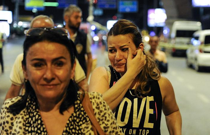 <p>Passengers who survived from the suicide bomb attack cry as they leave the Turkey's largest airport, Istanbul Ataturk, June 28, 2016, Turkey. (Gokhan Tan/Getty Images) </p>