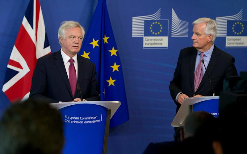 EU Chief Brexit Negotiator Michel Barnier, right, and British Secretary of State David Davis make statements as they arrive at EU headquarters in Brussels - Credit: AP Photo/Virginia Mayo