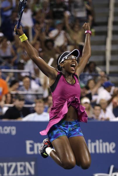 Victoria Duval, of the United States, leaps in celebration after defeating Samantha Stosur, of Australia, in the first round of the 2013 U.S. Open tennis tournament, Tuesday, Aug. 27, 2013, in New York. Duval won 5-7, 6-4, 6-4. (AP Photo/Charles Krupa)
