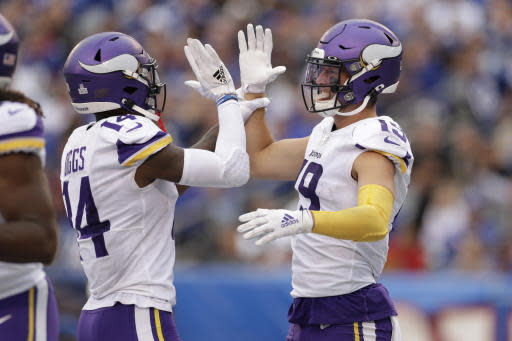 Minnesota Vikings wide receiver Adam Thielen (19) and Minnesota Vikings wide receiver Stefon Diggs (14) celebrate after a touchdown against the New York Giants during the third quarter of an NFL football game, Sunday, Oct. 6, 2019, in East Rutherford, N.J. (AP Photo/Adam Hunger)