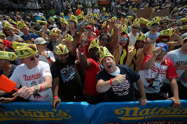 <p>Attendees gather before Nathan's Famous Fourth of July International Hot Dog-Eating Contest at Coney Island in Brooklyn, New York City, U.S., July 4, 2017. (Andrew Kelly/Reuters) </p>