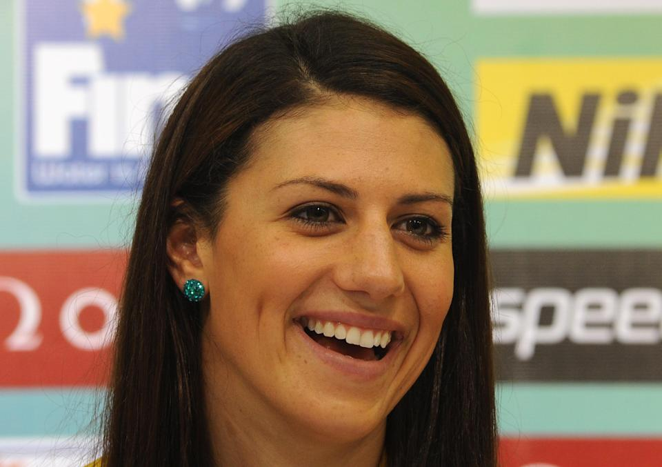 Australia's Stephanie Rice smiles during a press conference given by members of the Australian swimming team during the FINA World Championships at the indoor stadium of the Oriental Sports Centre in Shanghai on July 22, 2011. (PETER PARKS/AFP/Getty Images)