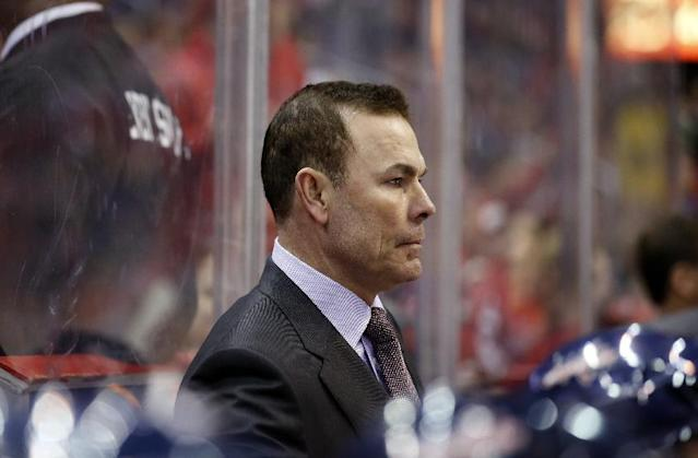 FILE - This Feb. 6, 2014 file photo shows Washington Capitals head coach Adam Oates on the bench in the third period of an NHL hockey game against the Winnipeg Jets, in Washington. Alex Ovechkin and the Washington Capitals are fading. Ovechkin has gone without a point in the last four games, and his team has lost five of its past six to drop to 10th in the Eastern Conference. (AP Photo/Alex Brandon, File)