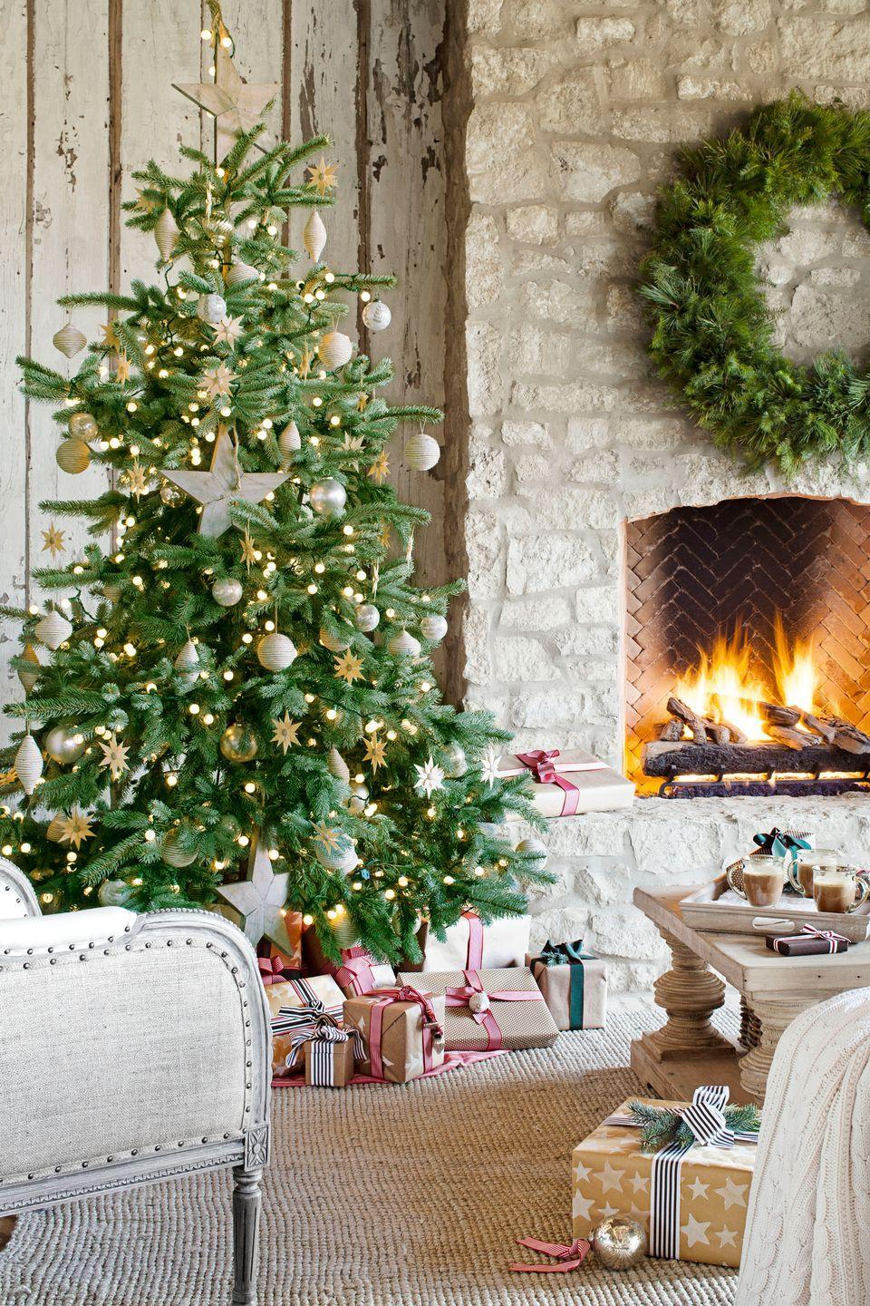 <p>A stone fireplace keeps things toasty on this covered patio, furnished like a full-fledged living room, complete with Christmas tree. </p>