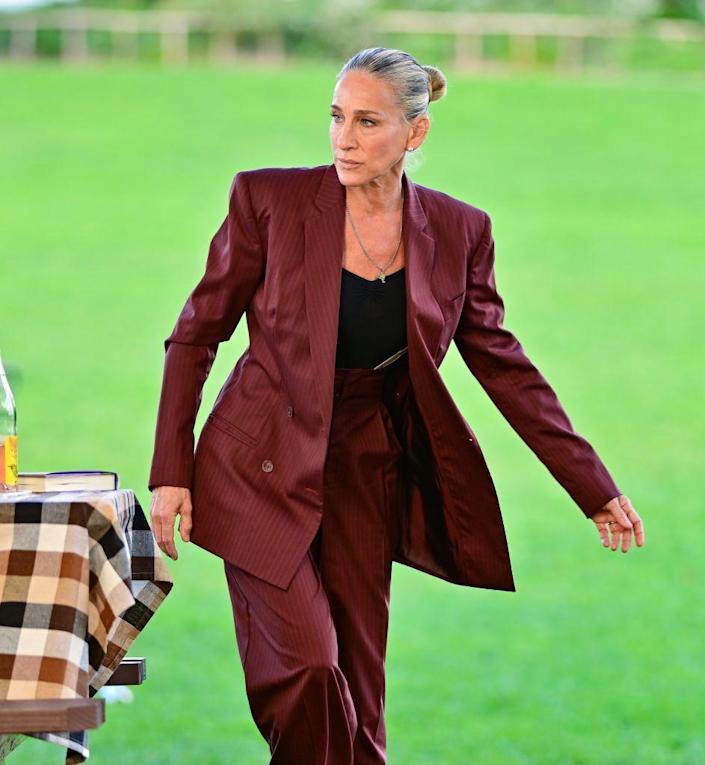 <p>Parker looked all business in a vintage Gucci burgundy striped suit, paired with vintage Manolo Blahnik BB leather pumps and a vintage Chanel lambskin leather flap clutch (not pictured). </p>